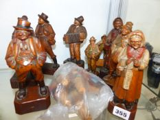 A GROUP OF CARVED BLACK FOREST TYPE WOODEN FIGURES.