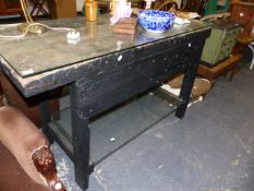 AN ANTIQUE WORK TABLE WITH LATER GLASS TOP.