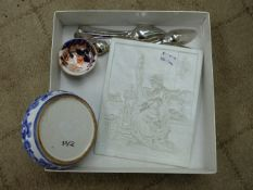 A SPODE TEA BOWL, PLATED CUTLERY, BLUE AND WHITE SHALLOW DISH AND A COUNTER RELIEF CARVED TILE.