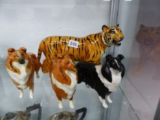 A BESWICK TIGER AND THREE COLLIE DOGS.