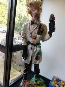 A LIFE SIZE FIGURE OF A MAD SCIENTIST.