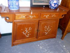 AN ORIENTAL HARDWOOD SIDE CABINET WITH MOTHER OF PEARL INLAY.