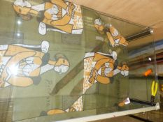 A PICASSO GREEN MUSLIN SCARF PRINTED IN ORANGE, WHITE AND BLACK WITH SEATED WOMEN. 127 x 54cms.