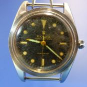 A VINTAGE ROLEX OYSTER PERPETUAL SUBMARINER BREVET 6204 WATCH, CASE NUMBER 988964. BELONGING TO JOHN