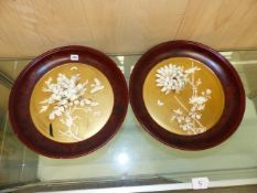 A PAIR OF JAPANESE BONE AND MARINE IVORY INLAID GOLD LACQUER WALL DISHES A BIRD AND A BUTTERFLY