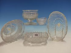 A CUT CLEAR GLASS SWEETMEAT, A WAVY RIMMED SALT AND THREE CUT CLEAR GLASS SHALLOW BOWLS, THE WIDEST.