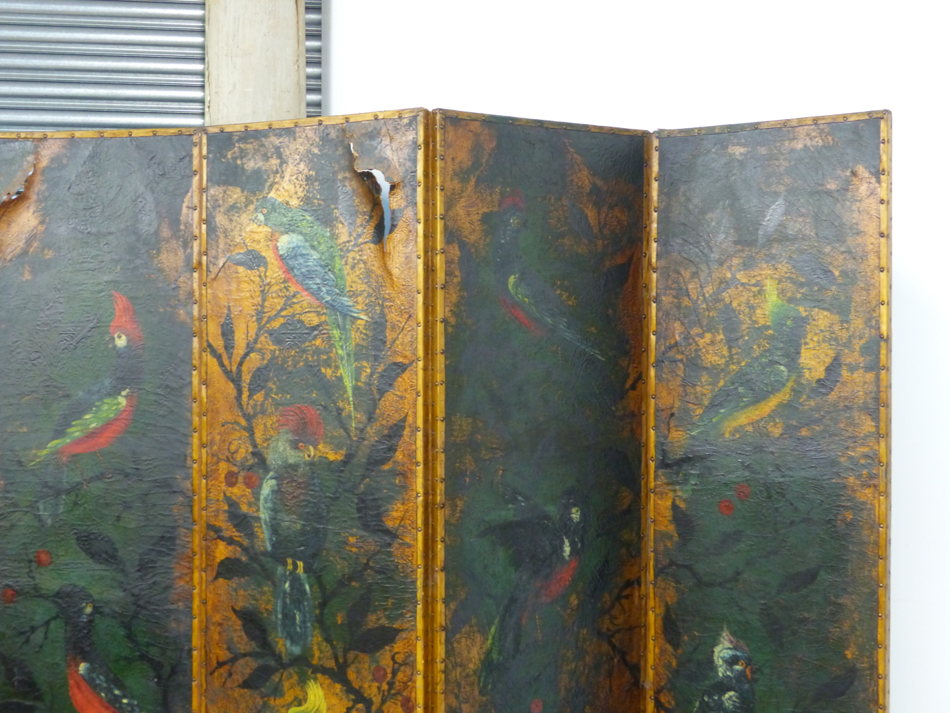 Lot 814A - AN IMPRESSIVE PAIR OF VICTORIAN AESTHETIC FOUR FOLD SCREENS WITH HAND PAINTED LEATHER PANELS DEPICT