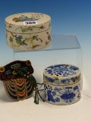 TWO CHINESE CYLINDRICAL BOXES AND COVERS, THE LID OF THE LARGER FAMILLE ROSE BOX PAINTED WITH A