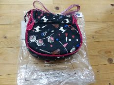 A RADLEY BLACK TEXTILE SHOULDER BAG WITH RED EDGINGS AND STRAP, THE TEXTILE DECORATED WITH WHITE
