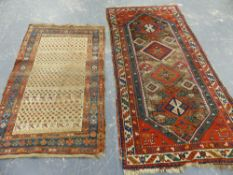 AN ANTIQUE CAUCASIAN RUG TOGETHER WITH AN ANTIQUE PERSIAN TRIBAL RUG 176 x 102cms AND 239 x 115cms.