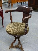 A MAHOGANY DESK OR CAPTAINS CHAIR WITH CIRCULAR SEAT UPHOLSTERED IN OLIVE GREY CUT VELVET AND
