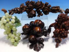 THREE CARVED WOOD PENDANTS OF FRUIT AND FLOWERS, THE LARGEST. H 32cms TOGETHER WITH TWO HARDSTONE
