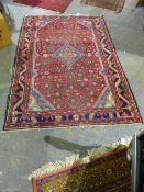 A PERSIAN HAMADAN RUG 197 x 131cms.