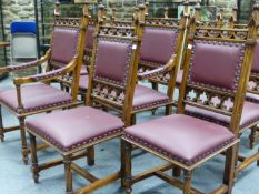 A SET OF TEN NEOGOTHIC OAK CHAIRS AND A REFECTORY TABLE BY BRIGHTS OF NETTLEBED, THE CHAIRS