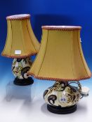 TWO MOORCROFT LAMP BASES SLIP TRAILED IN 1980'S STYLE WITH BUTTERFLIES AND BLACK BORDERED STYLISED