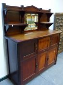 AN ARTS AND CRAFTS 1/4 SAWN OAK SIDE CABINET WITH RAISED SHELF BACK OVER ARRANGEMENT OF CABINET DOOR