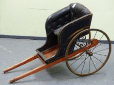 A 19th C. CHILD'S DOG CART, THE BUTTON UPHOLSTERED SEAT ABOVE A RED FOOT WELL, THE IRON SPOKED