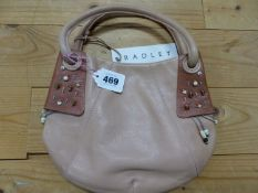 A RADLEY PALE TERRACOTTA LEATHER HANDBAG, THE DARKER CORNERS APPLIED TO ONE SIDE SEWN WITH BEADED