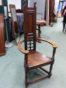 AN ARTS AND CRAFTS 'SHAKESPEARE' STAINED OAK ARMCHAIR, IN THE MANNER OF E.W.GODWIN, THE HIGH BACK