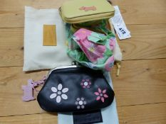 A RADLEY YELLOW LEATHER ZIP UP CASED FOLD AWAY BUTTERFLY BAG TOGETHER WITH A FLOWER SEWN BLACK