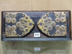 A COROMANDEL WOOD BOOK SLIDE WITH THE GOTHIC ARCH ENDS BRASS MOUNTED WITH THREE SPRAYS OF THREE