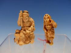TWO IVORY GROUPS OF SHOKI THE DEMON QUELLER, THE TALLER. H 6.5cms