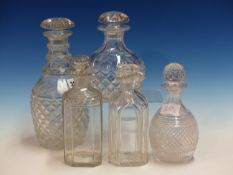 FIVE VARIOUS CUT GLASS DECANTERS AND STOPPERS.