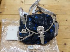 A RADLEY BLACK TEXTILE SHOULDER BAG PATTERNED WITH BLUE AND GREY BOWS, THE STRAP AND EDGINGS GREY/