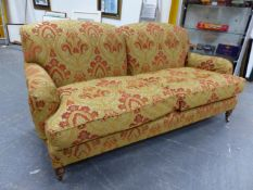 A BESPOKE HOWARD STYLE DEEP SEAT SETTEE UPHOLSTERED IN JIM DICKENS FABRIC WITH FEATHER FILLED