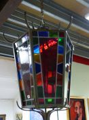 AN IMPRESSIVE BRONZE FRAMED HEXAGONAL HALL LANTERN WITH STAINED GLASS PANELS. MAX Dia.80cms x H.