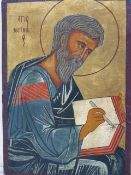 AN ICON OF A SAINT WRITING IN A BOOK, POSSIBLY ST PAUL, THE GREY CLOTHED FIGURE AGAINST A GILT