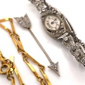 A DIAMOND SET ARROW STICK PIN. (5.7cms) TOGETHER WITH A DIAMOND AND SAPPHIRE WATCH FITTED ON A STEEL