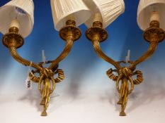 A PAIR OF ORMOLU TWO BRANCH WALL LIGHTS, THE CLASSICALLY DRAPED NOZZLES AND FLUTED ARMS ON RIBBON