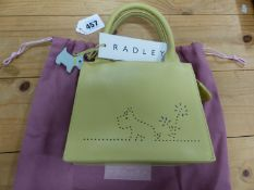 A RADLEY YELLOW LEATHER HANDBAG STIPPLE PIERCED ON ONE SIDE WITH A SCOTTIE DOG SEATED BY A FLOWER