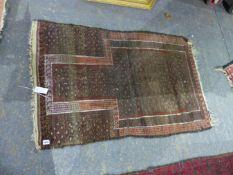 A TRIBAL BELOUCH PRAYER RUG 125 x 76cms.