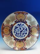 A FUKUGAWA IMARI DISH, THE RUYI FRAMED FLORAL LAPPETS ALTERNATING WITH STANDS OF BAMBOO AND