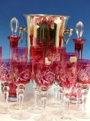 A SET OF SIX ROYAL DOULTON RUBY OVERLAY CUT GLASS WINES, SIX BOHEMIAN RUBBY OVERLAY CHAMPAGNE