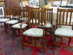 A SET OF TWELVE ARTS AND CRAFTS DINING CHAIRS IN THE MANNER OF LIBERTYS, (12)