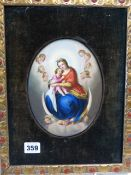 A FRAMED OVAL PORCELAIN PLAQUE PAINTED WITH THE MADONNA WITH THE CHRIST CHILD ON HER LAP AS SHE SITS