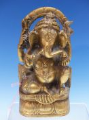 A POLISHED BRONZE METAL FIGURE OF GANESHA SEATED ON A LOTUS THRONE UNDER AND ARCHED MANDALA. H