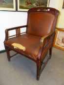 AN ARTS AND CRAFTS OAK SHOW FRAME ARMCHAIR, THREE BARS CENTRALLY BELOW EACH ARM ABOVE SQUARE LEGS