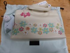 A RADLEY CREAM LEATHER WHISPER HANDBAG SEWN IN COLOURED LEATHERS WITH FLOWERS HEADS.