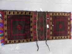 A BELOUCH TRIBAL SADDLE BAG 175 x 74cms.