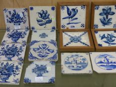 FIFTEEN DELFT BLUE AND WHITE TILES, MAINLY PAINTED WITH FLOWERS BUT THREE WITH FIGURES AND ONE
