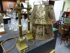 A PAIR OF BRASS ARTS AND CRAFTS STYLE TABLE LAMPS WITH PIERCED ARMORIAL CRESTED SHADES AND SQUARE