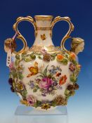 A LATE 19th C. GERMAN TWO HANDLED BALUSTER VASE, THE FEMALE HEADS BELOW THE HANDLE TERMINALS FLANKED