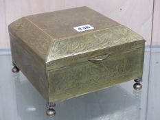 A MIDDLE EASTERN ENGRAVED BRASS CASKET WITH WOODEN LINER ON TURNED BRASS FEET. 19 x 19 x 13cms.