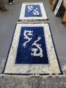 A PAIR OF CHINESE DRAGON DESIGN RUGS 187 x 124cms. x 2.