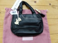 A RADLEY BLACK LEATHER HANDBAG WITH WHITE POKER DOT ZIP PULL AND LINING TOGETHER WITH A PINK TEXTILE