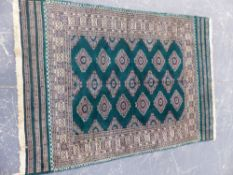 AN ORIENTAL RUG OF BOKHARA DESIGN 178 x 125cms.